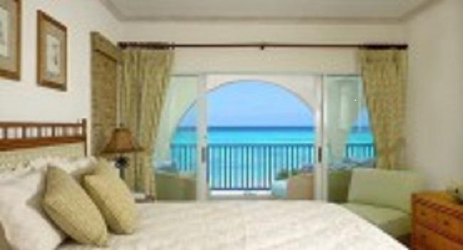 BARBADOS Condo- 2 bed 2 bath beachfront  apartment earns USD