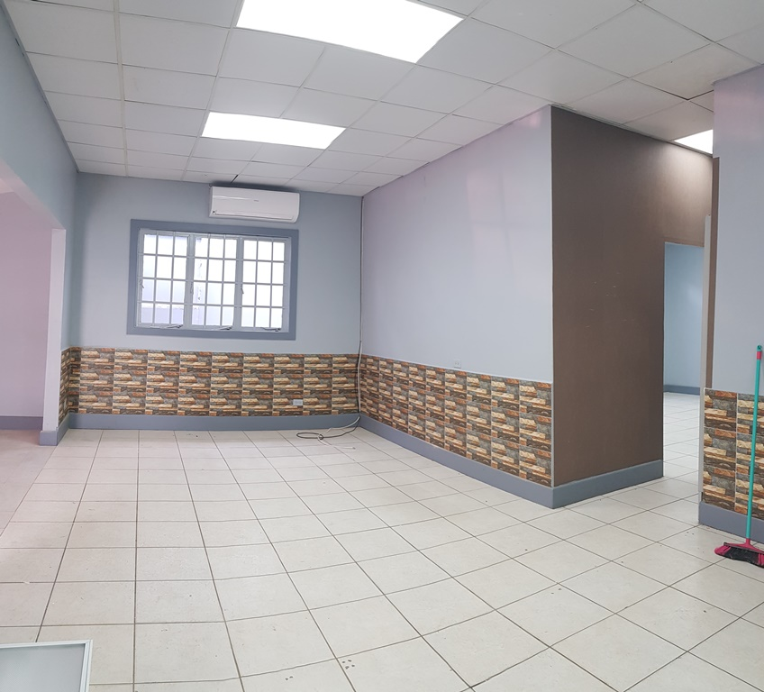 FOR RENT, Commercial building on Mucurapo Road for rent with four parking spots.