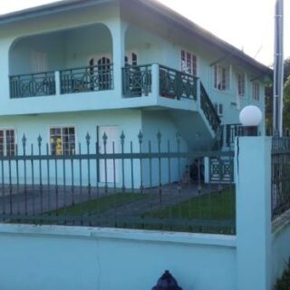 FOR SALE – 4 bedroom 2 bath home with 2  ground floor apartments.