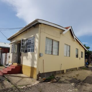 Mature home on 4550 sqft of land in the bustling hub of Woodbrook now for sale.